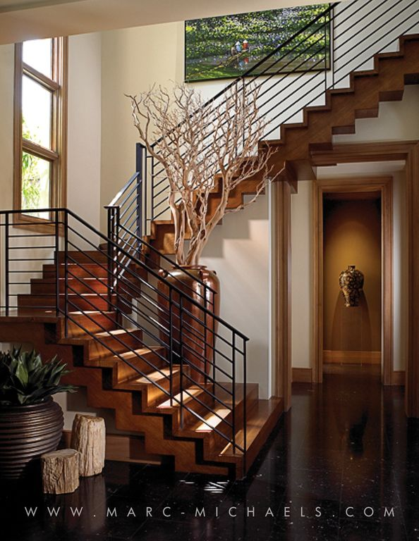 Contemporary Staircase with High ceiling, Hardwood floors, picture window, curved staircase