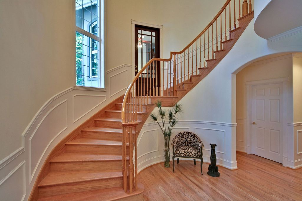 Traditional Staircase with Glass panel door, Standard height, Wainscotting, six panel door, Casement, curved staircase