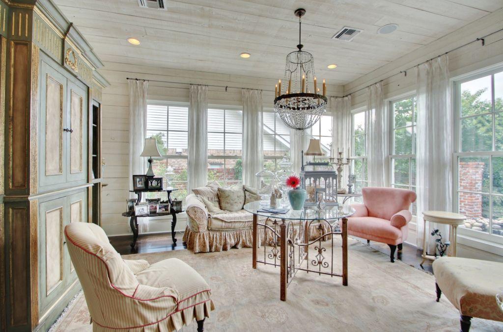 Eclectic Living Room with Standard height, Chandelier, Hardwood floors, Crown molding, Built-in bookshelf, double-hung window