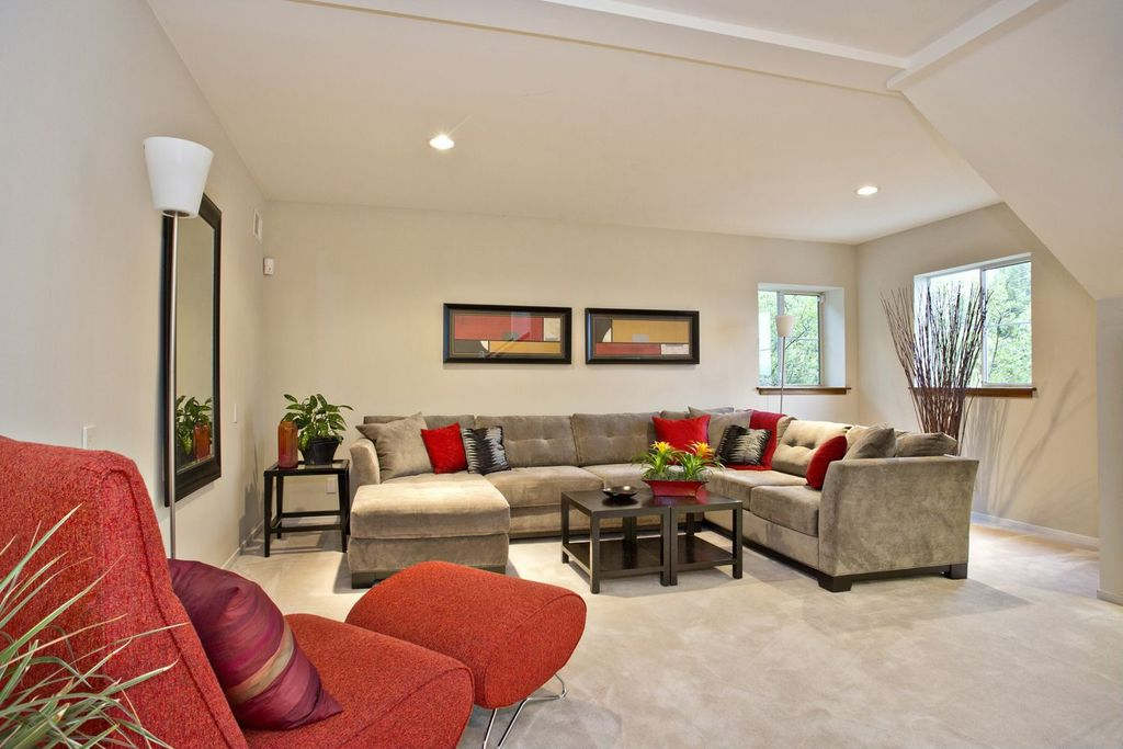 Contemporary Living Room with can lights, Exposed beam, Standard height, Carpet, Casement