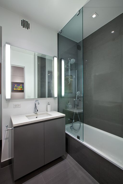 Contemporary Full Bathroom with can lights, European Cabinets, hollywood lights, frameless showerdoor, Undermount sink, Flush