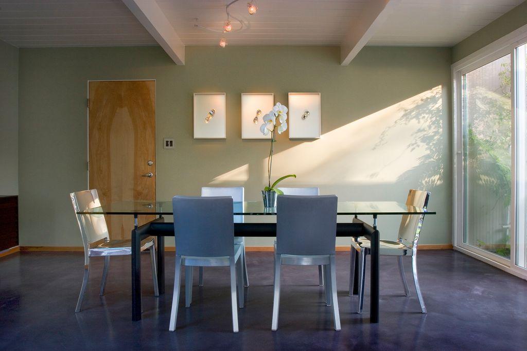 Modern Dining Room with flat door, simple granite floors, Exposed beam, Chandelier, Standard height, sliding glass door