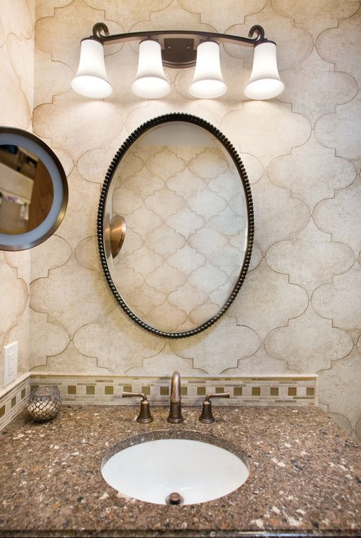 Mediterranean Powder Room with Ceramic Tile, wall-mounted above mirror bathroom light, Powder room, Standard height