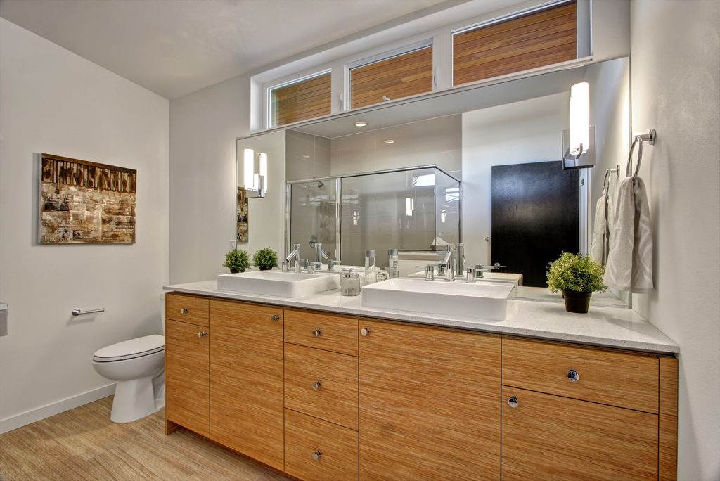 Contemporary 3/4 Bathroom with framed showerdoor, Simple granite counters, Double sink, can lights, picture window, Flush