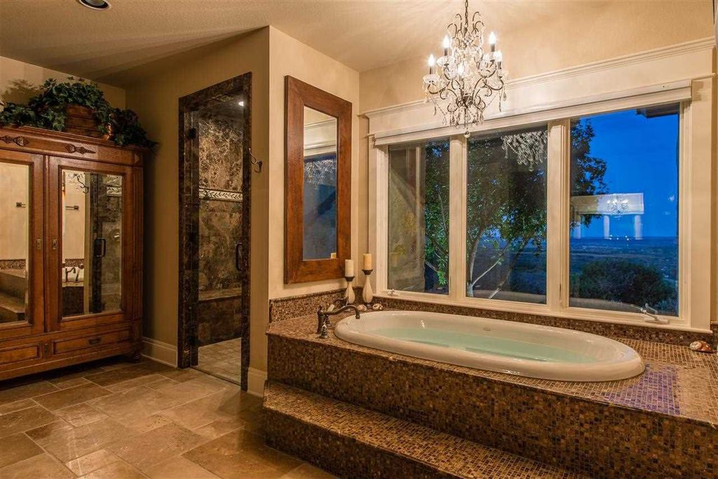Traditional Master Bathroom with Wall Tiles, Shower bench, stone tile floors, Glass panel, Paint, Mosaic tile, Flush, Bathtub