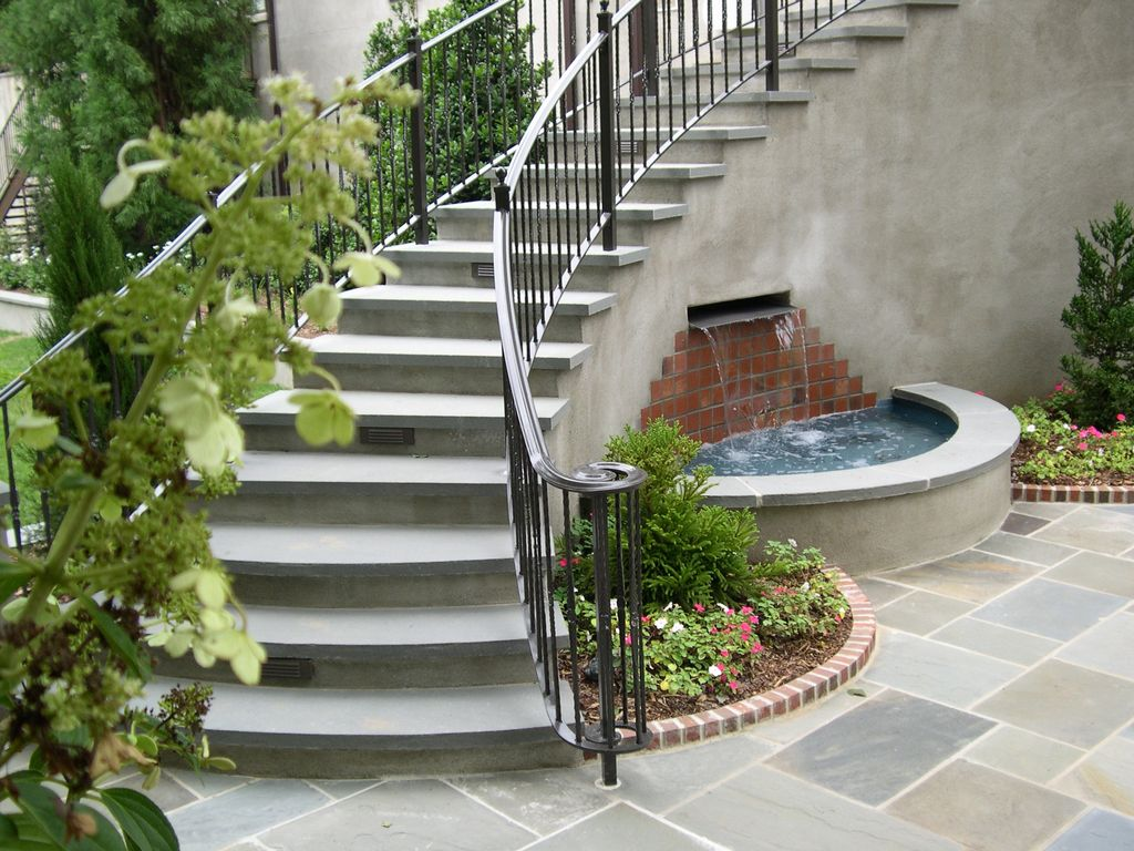 Traditional Staircase with Standard height, curved staircase, slate floors