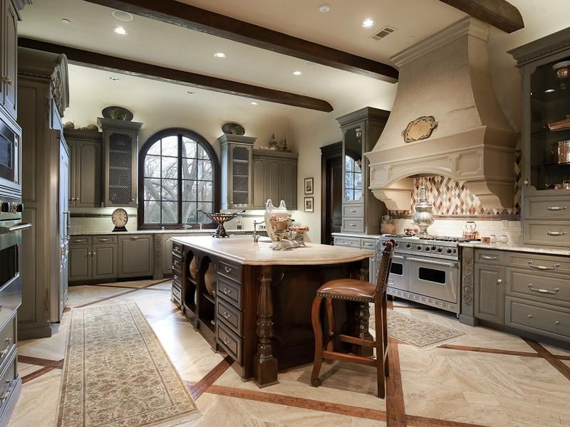 Traditional Kitchen with can lights, wall oven, Standard height, Arched window, full backsplash, Raised panel, Kitchen island