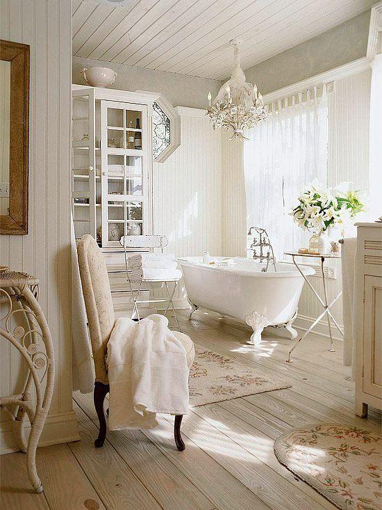 Cottage 3/4 Bathroom with three quarter bath, Clawfoot, Hardwood floors, Chandelier, Casement, Bathtub, Paint, Glass panel