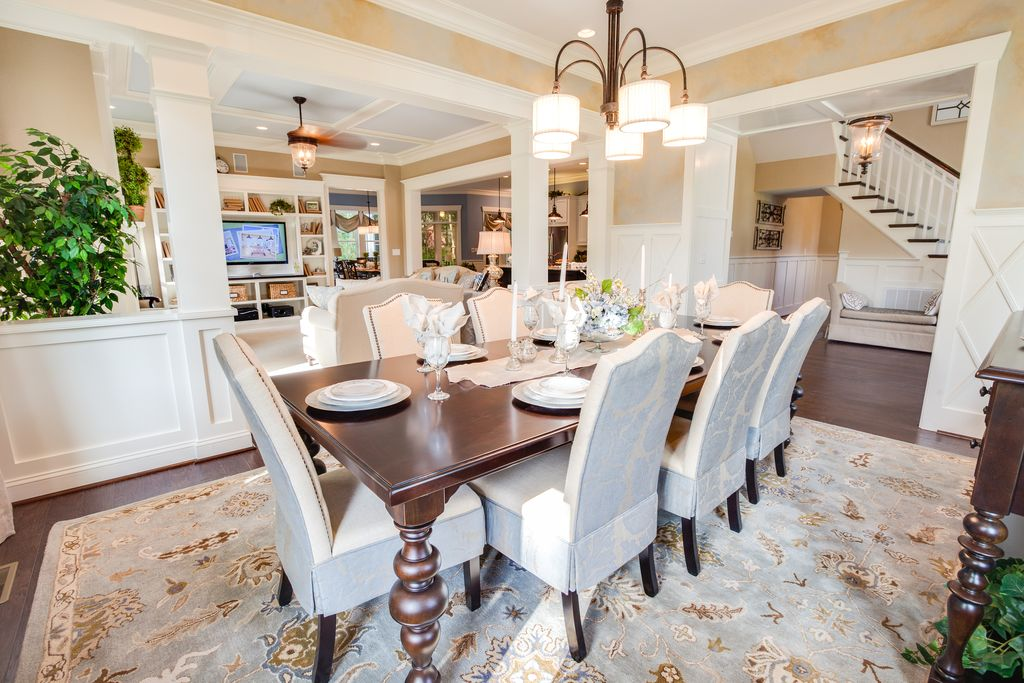 Traditional Dining Room with Crown molding, Hardwood floors, can lights, Columns, Chair rail, Wainscotting, Chandelier