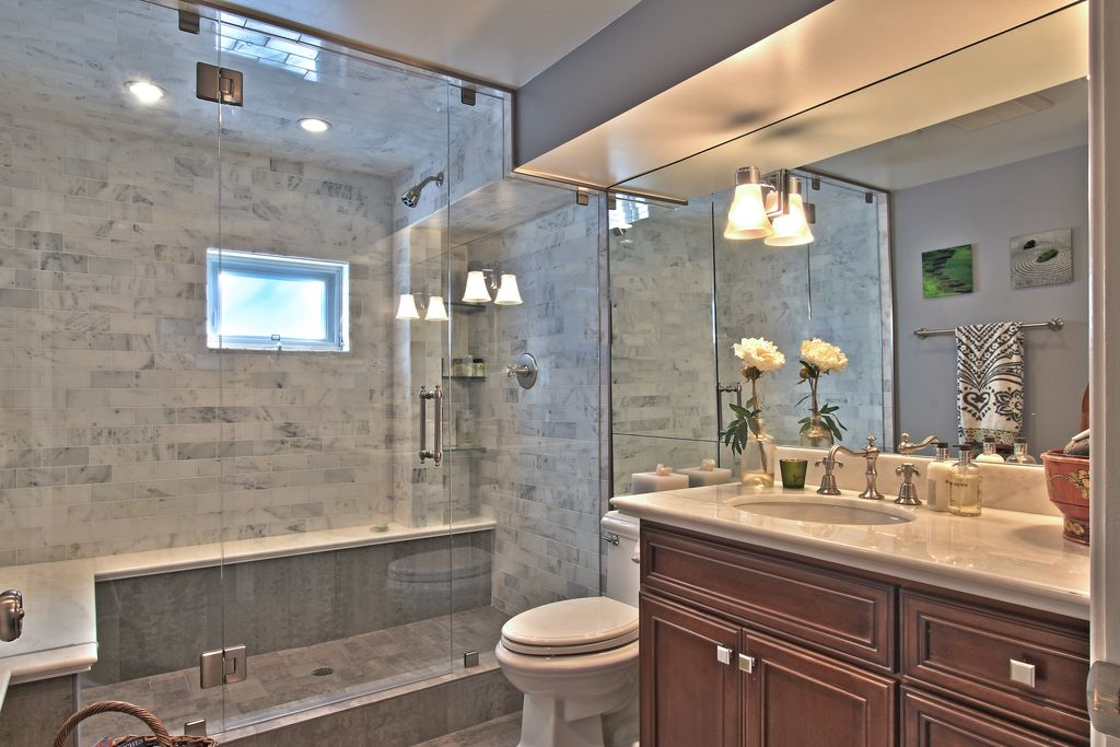 Traditional 3/4 Bathroom with Ms International Crema Marfil Classic Marble Countertop, can lights, flush light, Shower
