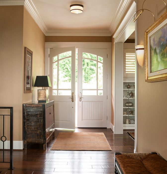 """Traditional Entryway with Hardwood floors, Crown molding, Feiss casual luxury 13"""" wide ceiling light fixture, Standard height"""