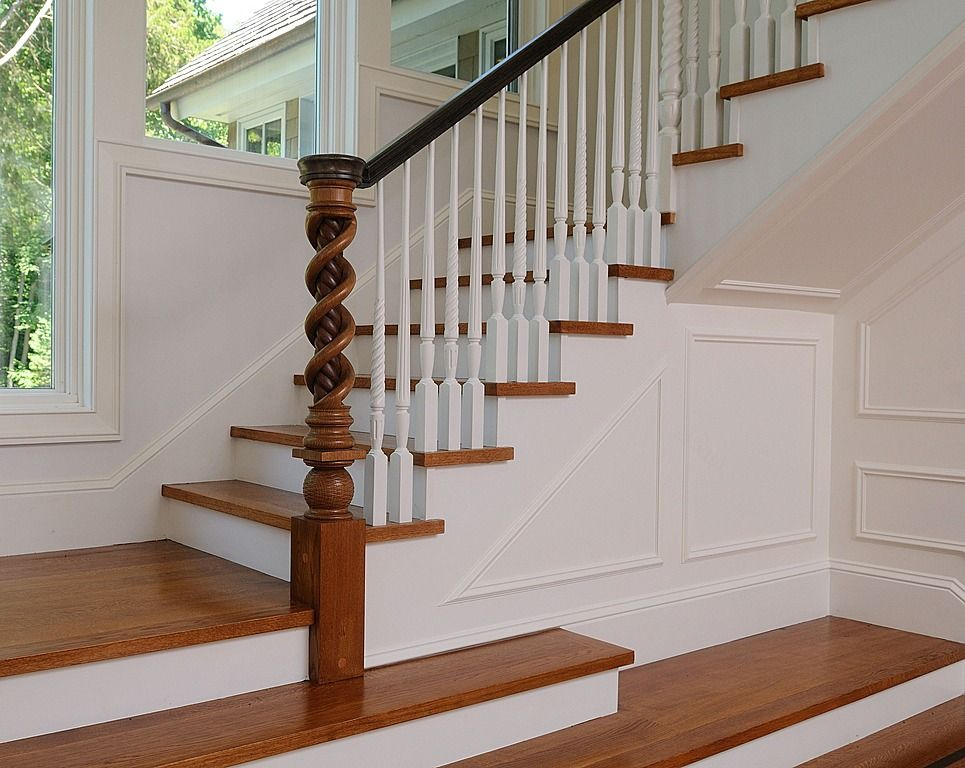 Traditional Staircase with curved staircase, picture window, Hardwood floors, Standard height, Wainscotting