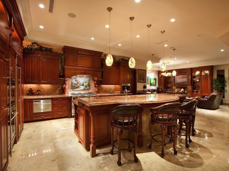 Kitchen with L-shaped, Breakfast bar, Standard height, can lights, Complex Granite, Pendant light, double wall oven, Mural