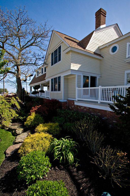 Country Landscape/Yard with sliding glass door, exterior stone floors, Deck Railing, picture window, double-hung window