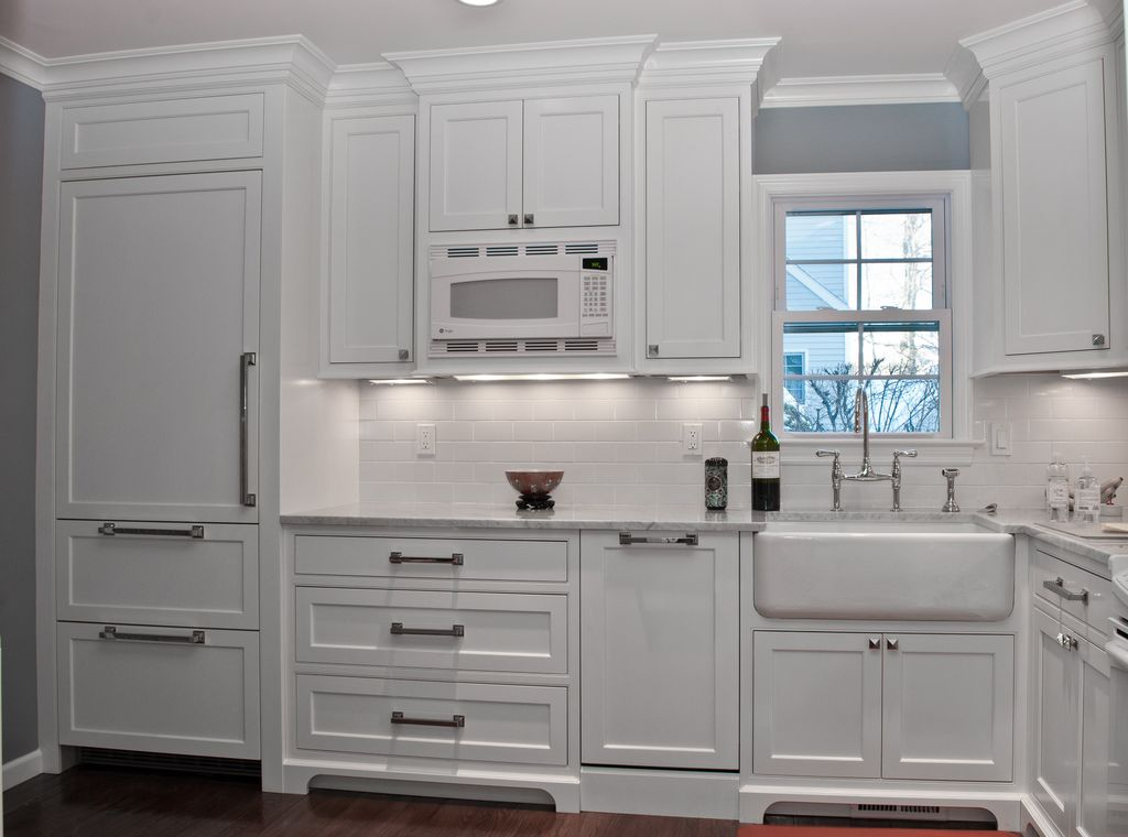 Traditional Kitchen with Crown molding, gas range, Farmhouse sink, Built In Panel Ready Refrigerator, Inset cabinets, Paint