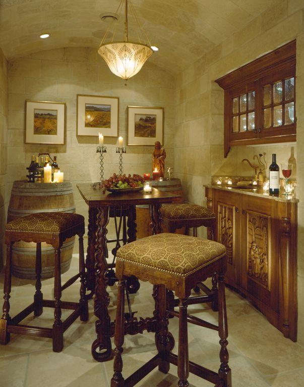 Eclectic Wine Cellar with Built-in bookshelf, sandstone floors, Standard height, flush light, can lights, Casement