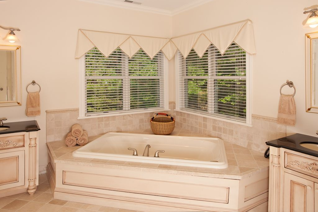 Country Master Bathroom with Flat panel cabinets, Bathtub, Corian counters, Undermount sink, Casement, Inset cabinets