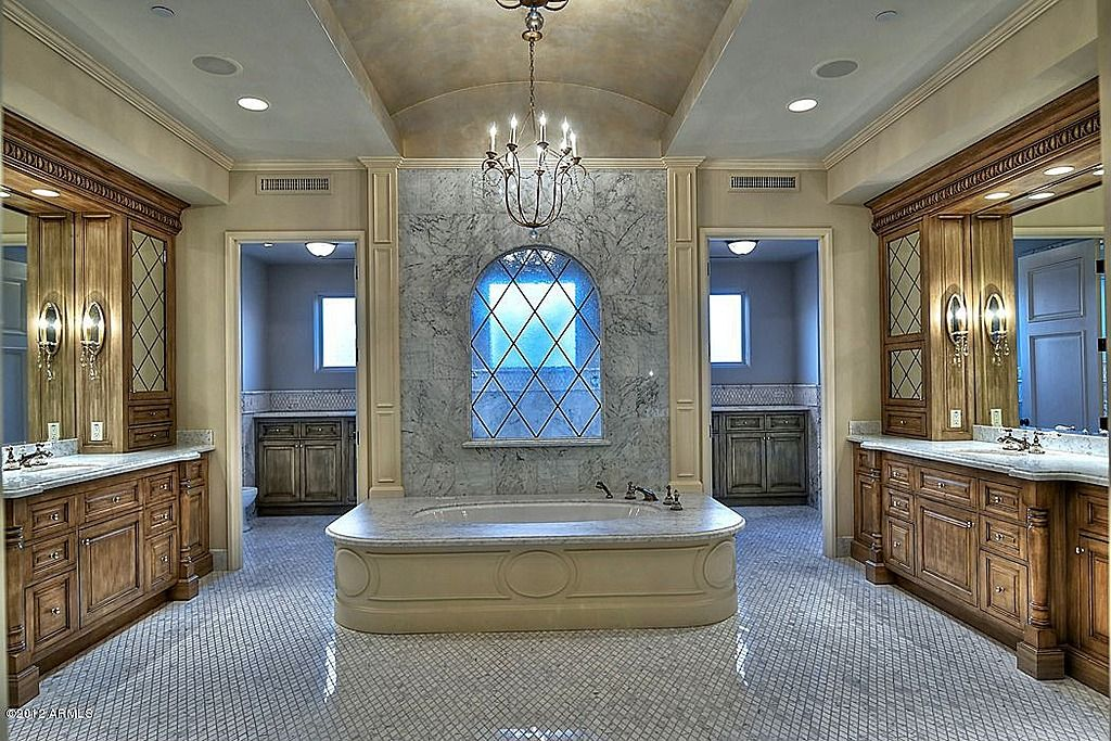 Traditional Master Bathroom with Simple granite counters, Wall sconce, High ceiling, ceramic tile floors, partial backsplash