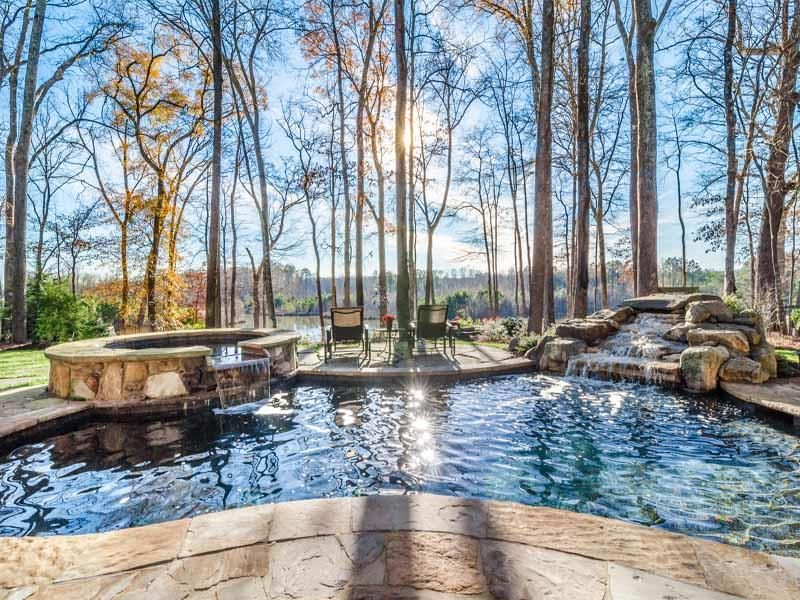Rustic Swimming Pool with exterior stone floors, Pool with hot tub, Fountain