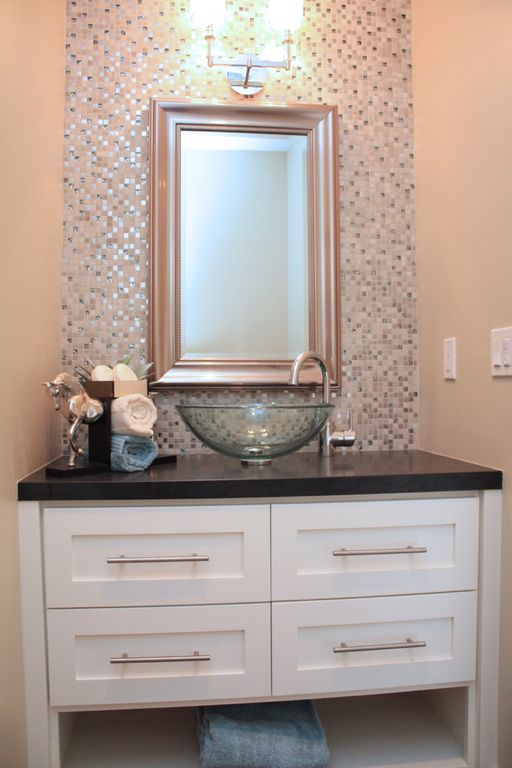 Modern Powder Room with Soapstone counters, Ceramic Tile, Vessel sink, Flat panel cabinets, full backsplash, Paint 1, Flush