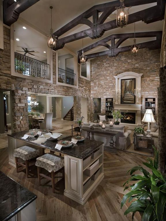 Traditional Great Room with Cathedral ceiling, Fireplace, Cement fireplace, Casement, Hardwood floors, Chandelier, Balcony