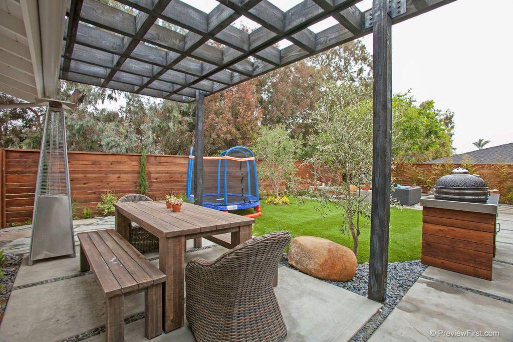 Contemporary Patio with Trellis, Fence, exterior concrete tile floors, Outdoor kitchen, exterior tile floors