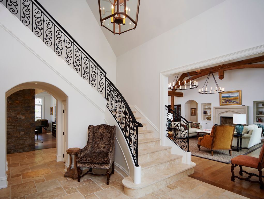Mediterranean Staircase with Tuscany classic wall and floor tile, Chandelier, Hardwood flooring, sandstone floors