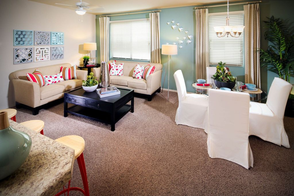 Contemporary Great Room with Ceiling fan, Carpet, Chandelier, Standard height