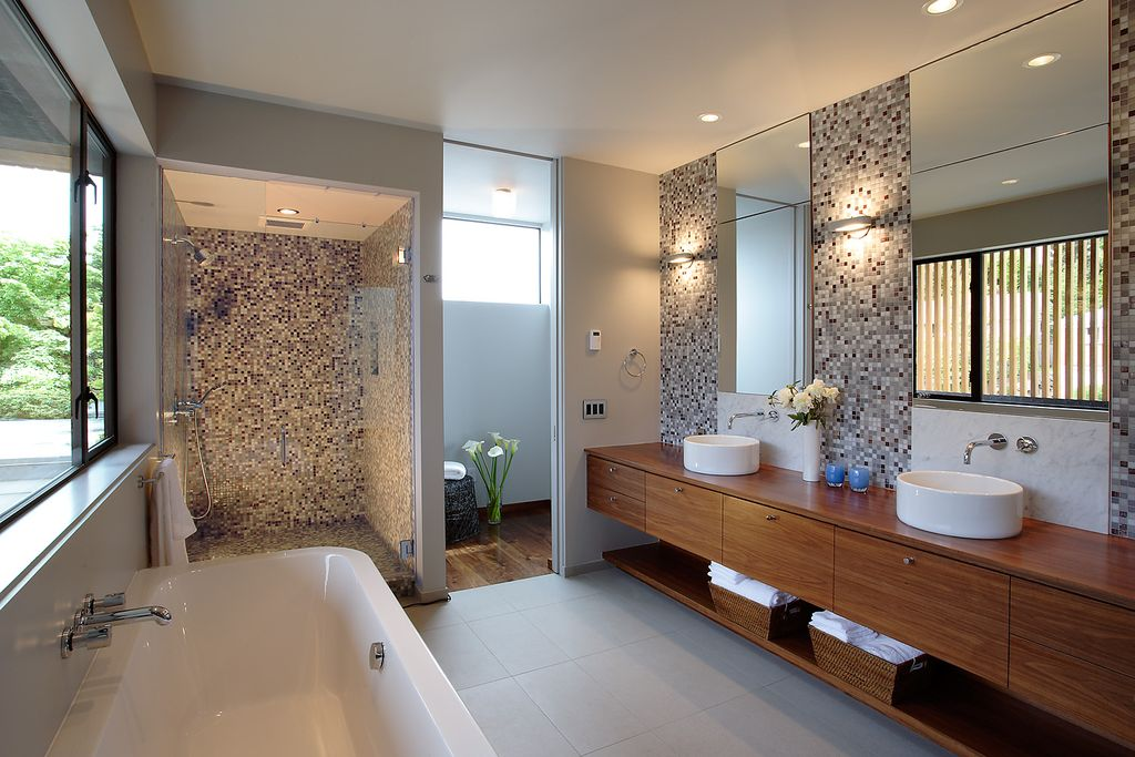 Contemporary Master Bathroom with Wood counters, Bathtub, Wall Tiles, Complex Marble, large ceramic tile floors, Wall sconce
