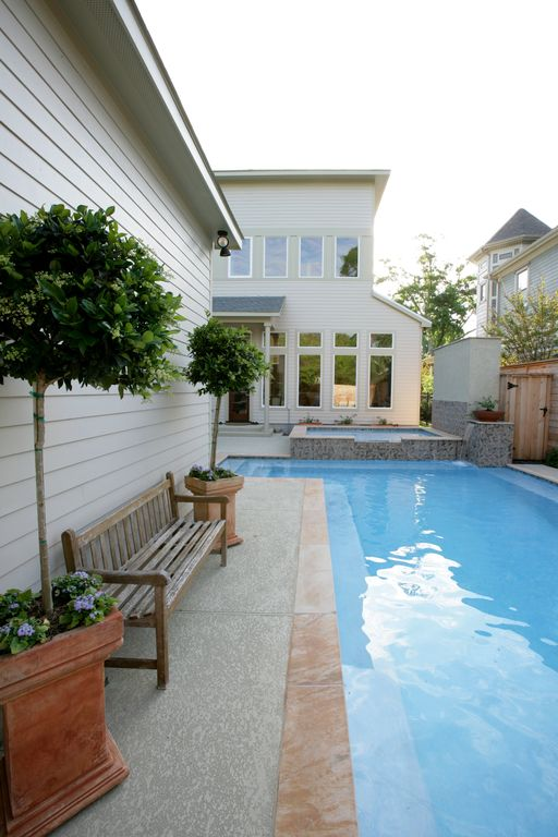 Modern Swimming Pool with Pool with hot tub, picture window, French doors, Fence, exterior concrete tile floors, Pathway