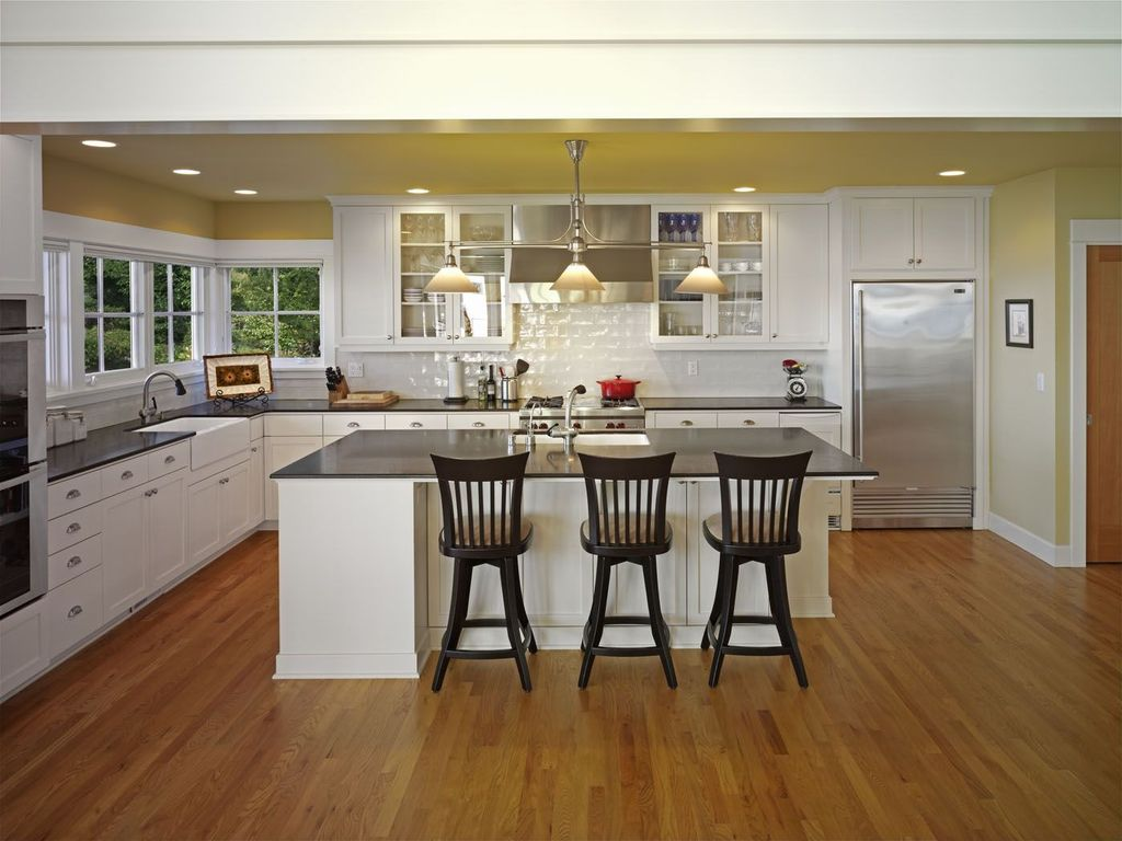 Traditional Kitchen with Glass panel, Farmhouse sink, gas range, Flush, Built In Refrigerator, Absolute black, L-shaped
