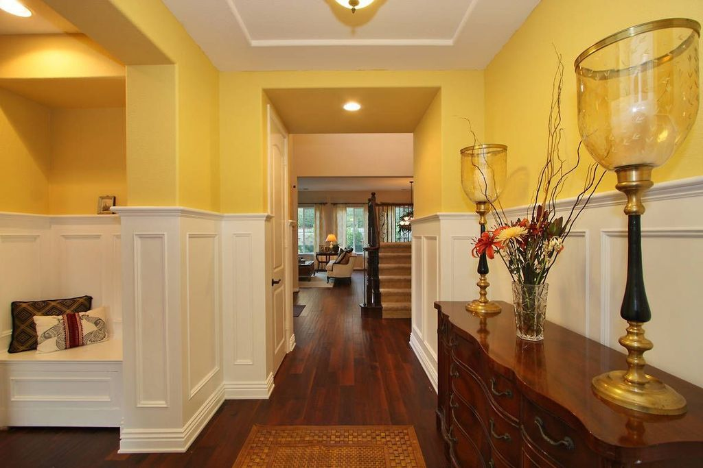 Traditional Hallway with Wainscotting, Standard height, can lights, six panel door, Hardwood floors