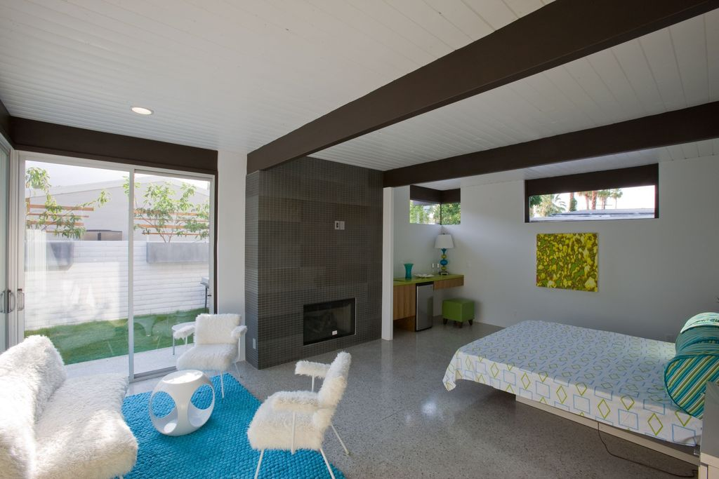 Contemporary Guest Bedroom with Fireplace, can lights, sliding glass door, Standard height, insert fireplace