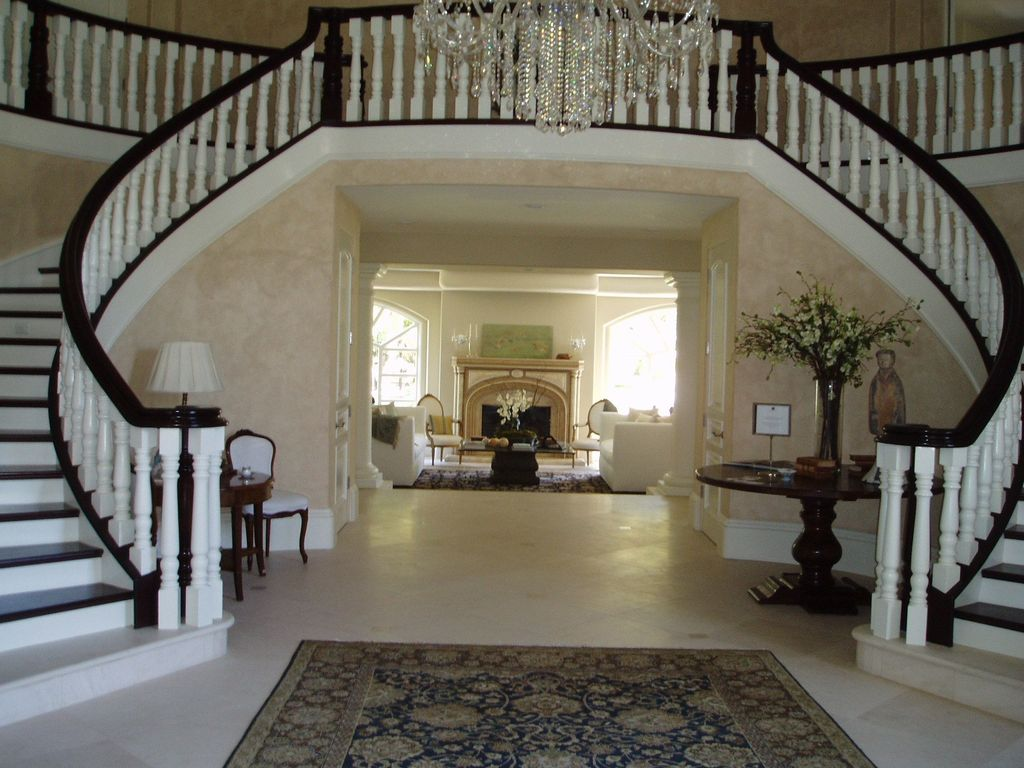 Traditional Staircase with High ceiling, Double staircase, Hardwood floors, Chandelier, interior wallpaper