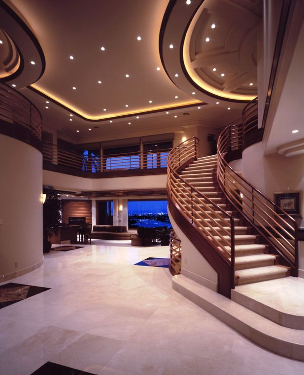 Contemporary Staircase with curved staircase, Hardwood floors, can lights, High ceiling