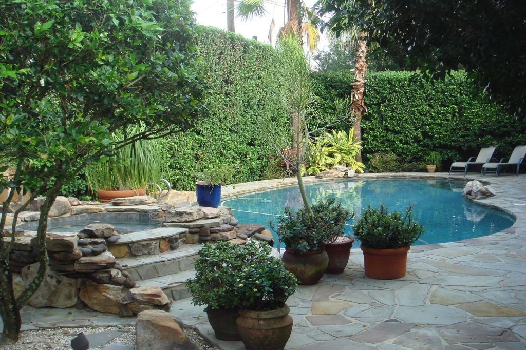 Rustic Swimming Pool with Fence, Pool with hot tub, exterior stone floors