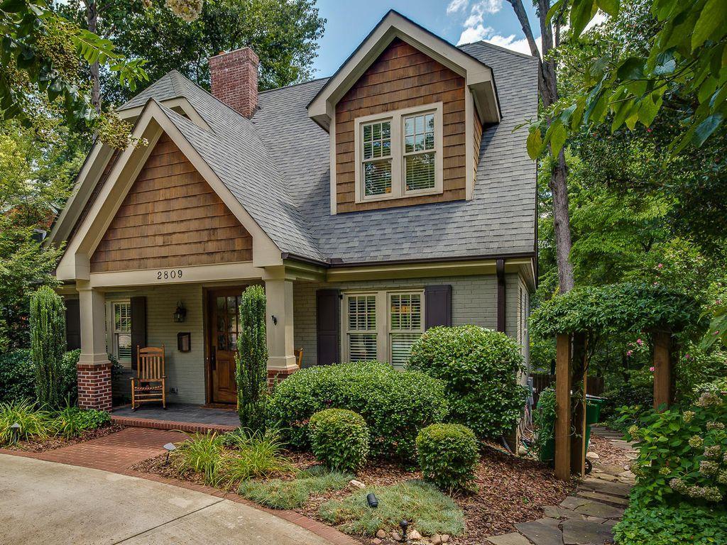 Craftsman Exterior Of Home With Glass Panel Door & Arbor