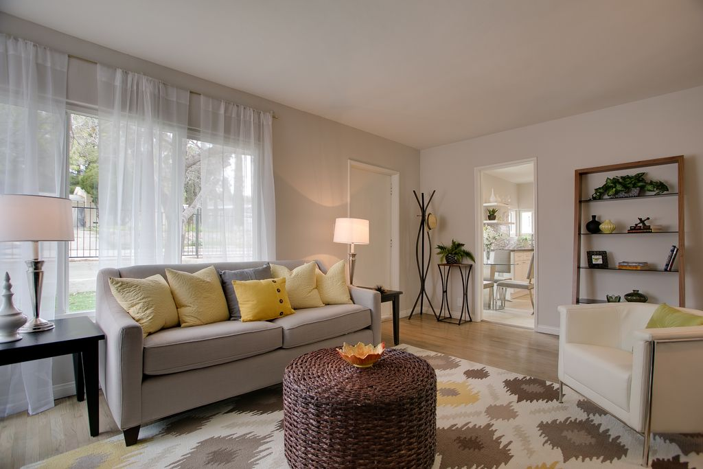 Contemporary Living Room with Carpet, West Elm Paidge Sofa, Hardwood floors, Riverside Home Office Leaning Bookcase